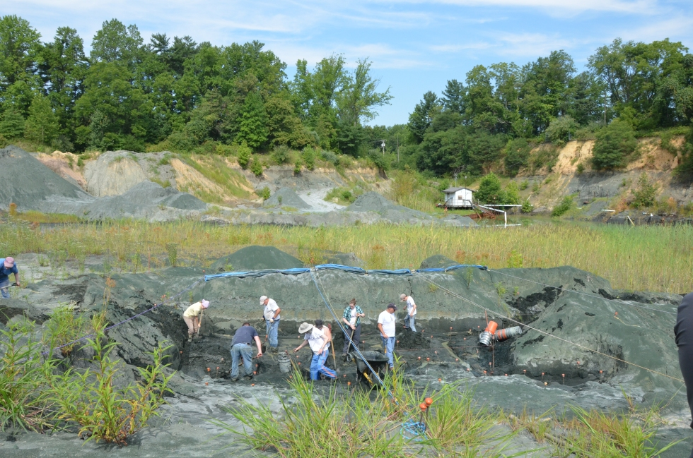 Students and volunteers dig at a fossil pit in New Jersey