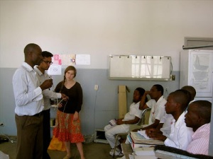 Dhairya Pujara teaching a group of doctors in a hospital in Mozambique.