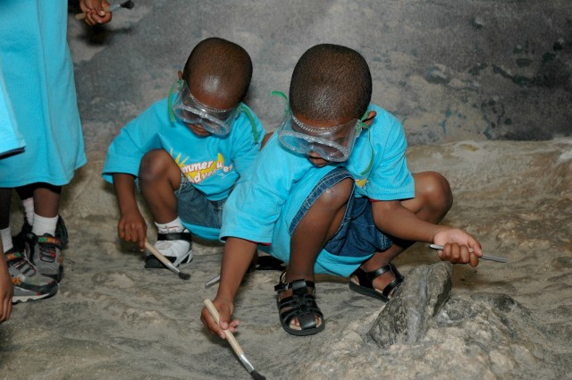 "The ""Big Dig"" interactive paleontology exhibit requires children to wear protective goggles, which some sensitive children may find uncomfortable. Photo credit: Bruce Tepper/ANSP"