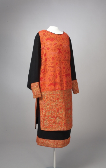 A 2-piece day dress from the French couture house of Callot Soeurs from their fall 1927 collection. Callot Soeurs were known for their simple modern silhouettes as well as their lavish embellishment. This cashmere tunic-style dress has a Persian influence.