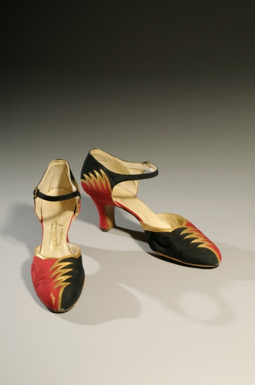 "1.A pair of black and red evening shoes with a ""lightning bolt"" bolt motif from the late 1920s. The shoes of the 1920s are spectacular. Skirts were the shortest they had been for a millennium, so sheer stockings and flashy shoes were the latest fashion. The lightning bolt motif was fashionable in this period since it was associated with modern technology such as the telegraph and radio."