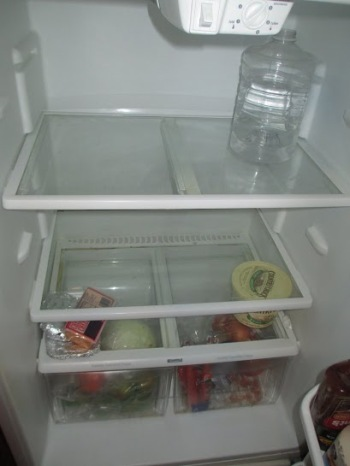 That's the fridge when it's empty. That's at the ending of the month, when it was a little empty, but we didn't have to go to a church to get food or anything like that. Like we weren't at the point of starving. - Photo and Voice by Christie, Camden