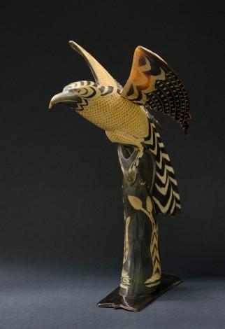 A buffalo horn in the shape of an eagle.