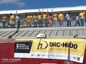 DRC-Hubo team members and supporters cheer the team's two-point performance in the ladder climbing event.
