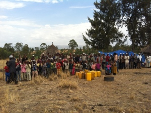 Community members take part in a well drilling project in Ethiopia.
