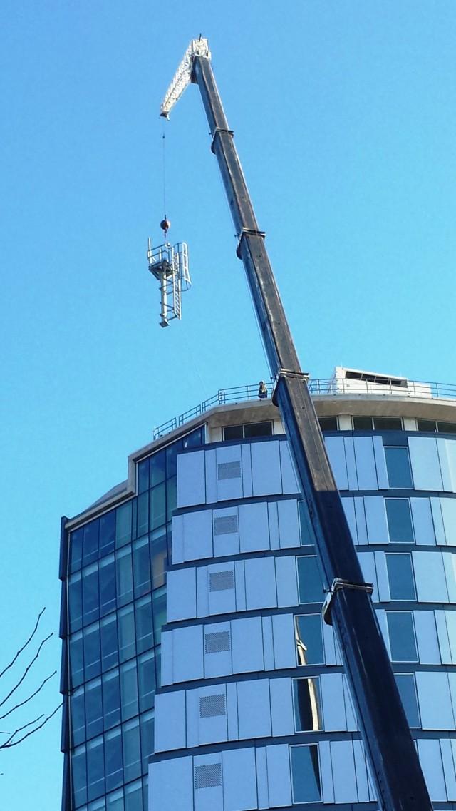 Millennium antenna_Crane Boom Mast at Roof 1