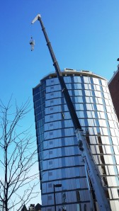 The 19.5-foot antenna is affixed to the top of the 205-foot Millennium Hall dormitory.