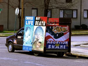 A pro-life van parked outside of an abortion clinic.