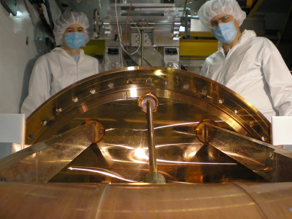 Michelle Dolinski and an engineer during the installation of the EXO-200 detector
