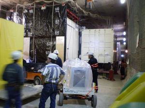During the installation of the EXO-200 detector, the time projection chamber for holding liquid xenon was transported in a protective box into a clean room to minimize its exposure to outside radiation.