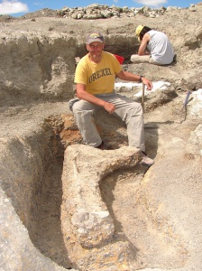 Kenneth Lacovara in a field of Dreadnoughtus ribs.
