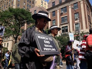 Veiled demonstrators protest racial bias in policing with a march to Bloomberg's house on June 17, 2012