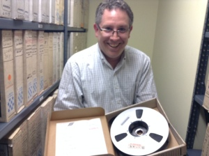"Toby Seay, project director of Drexel's Audio Archives and an associate professor in the Westphal College, holds ""Reel 4."""