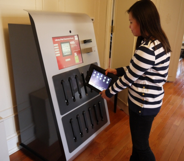 Christine Liu, an administrative coordinator at Drexel Libraries, checks out the University's new iPad vending machine.