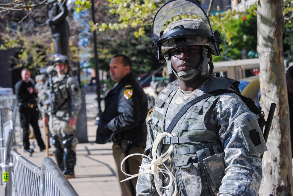 A Maryland Army National Guard soldier keeps watch in front of Baltimore City Hall on April 28.