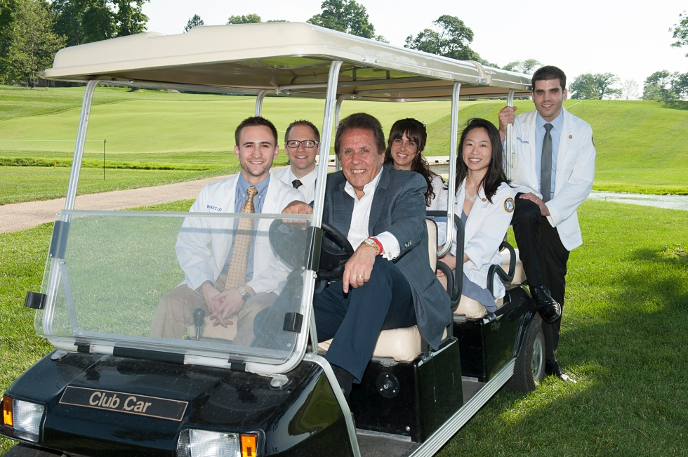 Behind the wheel, Manual Stamatakis is pictured with five of seven scholarship recipients: Brian Lefchak (front seat); Blake Bowden; Melanie Dabakis; Jennifer Hong (middle seat); and Yehuda Kerbel  (back). Not pictured: Christopher Scanlon and Alexandra Tilocca.