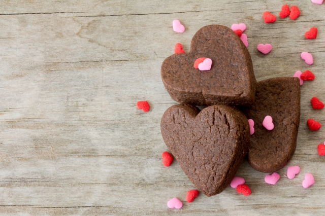 Heart Cookies on Table with Sprinkles Close Up