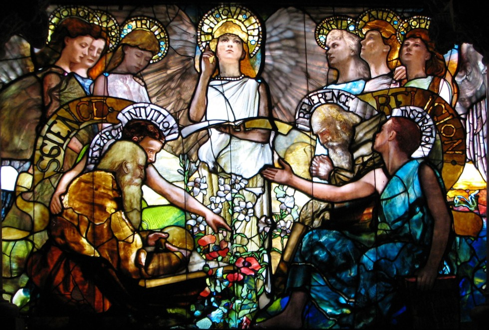 Science and Religion are portrayed to be in harmony in the stained glass window entitled Education by artist Louis Comfort Tiffany (1890).