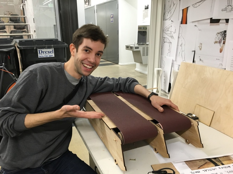 "Senior product design student Arvid Roach assembles the race track that will be driven with DC motors connected to an arduino board for the ""Dog vs. Cats a Race for Love"" project."