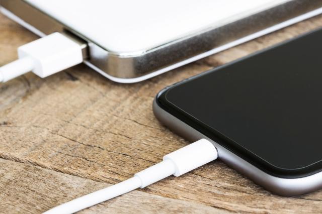 closeup phone charging white power bank portable device