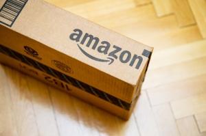 Amazon logotype printed on a cardboard box