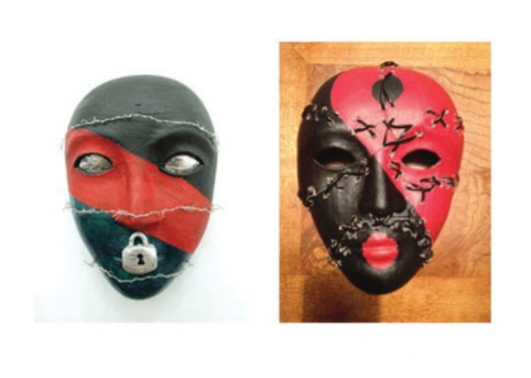 A pair of black and red masks, one with barbed wire around it and a lock on its mouth, and the other with stitches all across it.