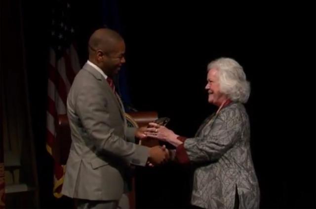 Corbin accepts a glass award