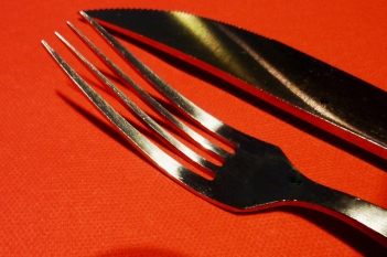 a fork and knife on a red background