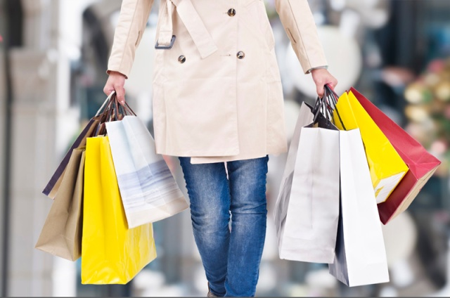 woman walking with shopping bags in hands, christmas background