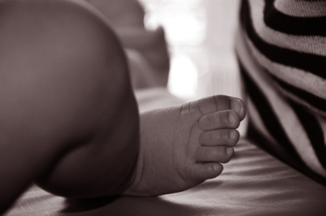 A black and white image of a newborn's foot