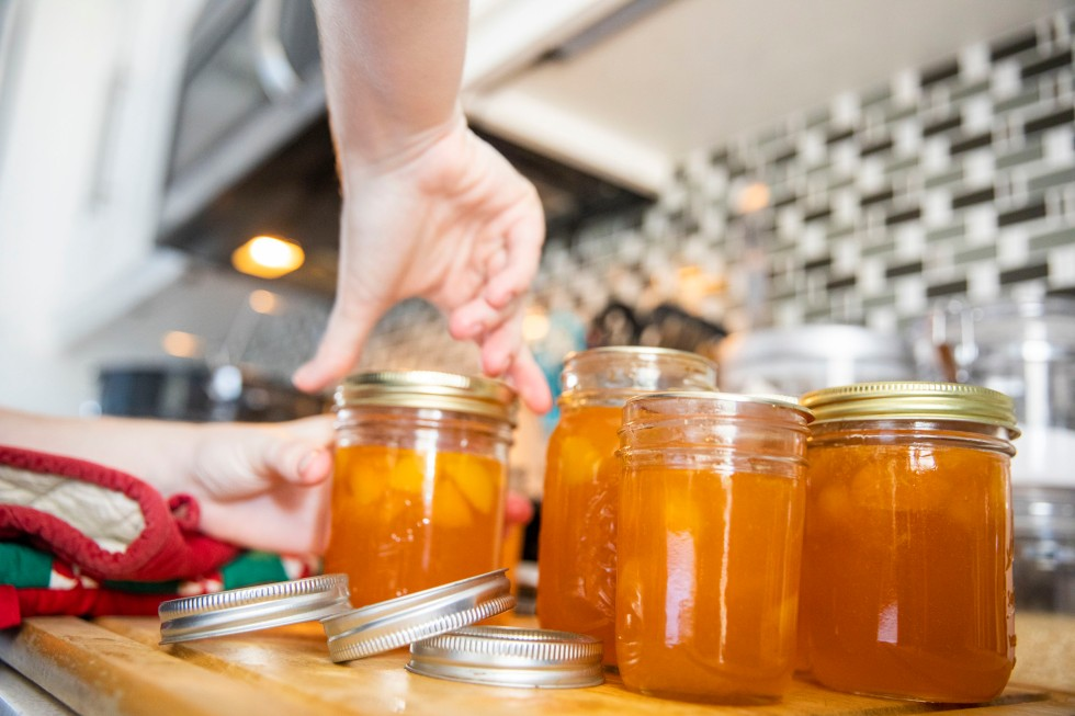 Making Apricot jam in a kitchen