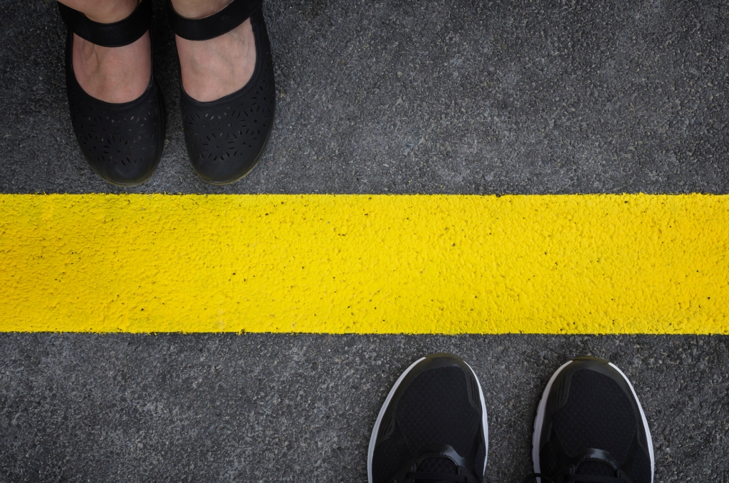 Two people divided by a yellow line